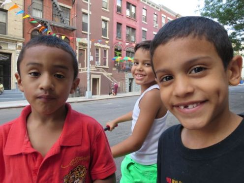Aidan (left) plays with friends on 159th Street