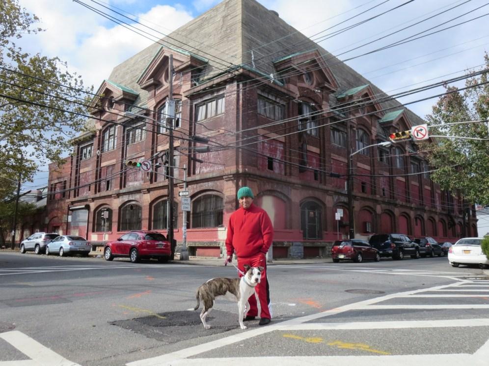 Neighborhood resident Angel and his dog Tigressa stand before Murphy Varnish