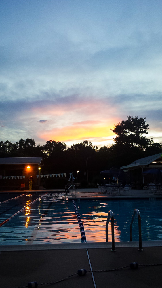sunset over the pool in summer