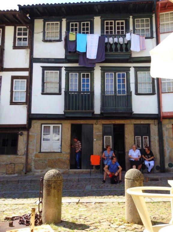 people sat on their doorstep in Amarante Portugal
