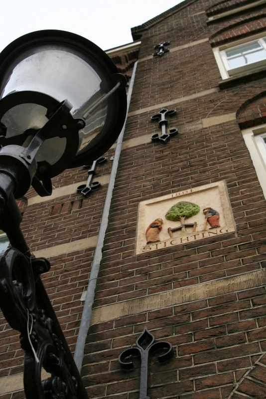 The plaques on the side of houses in Amsterdam represent the trades of the people who lived there