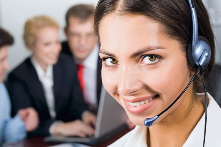 Portrait of friendly Virtual Assistant woman with headset