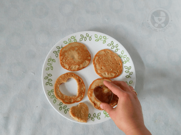 Cut the pancakes into heart shaped pieces