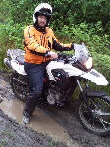 Me with my feet in the water and my soaked pants on the G650GS