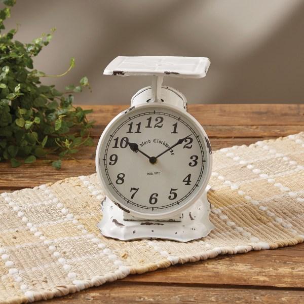 horloge balance blanche