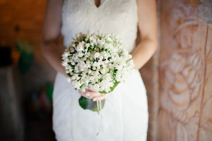 White bridal bouquet with touches of green.