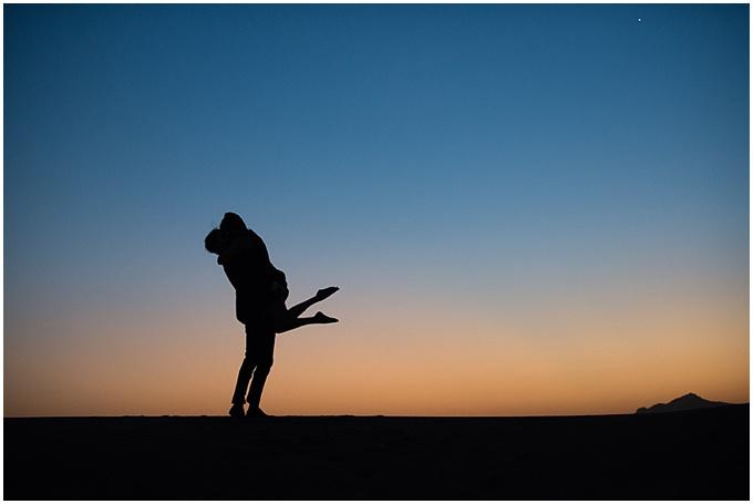 Love in the desert – sunset silhouette {Bernard Richardson Photography}