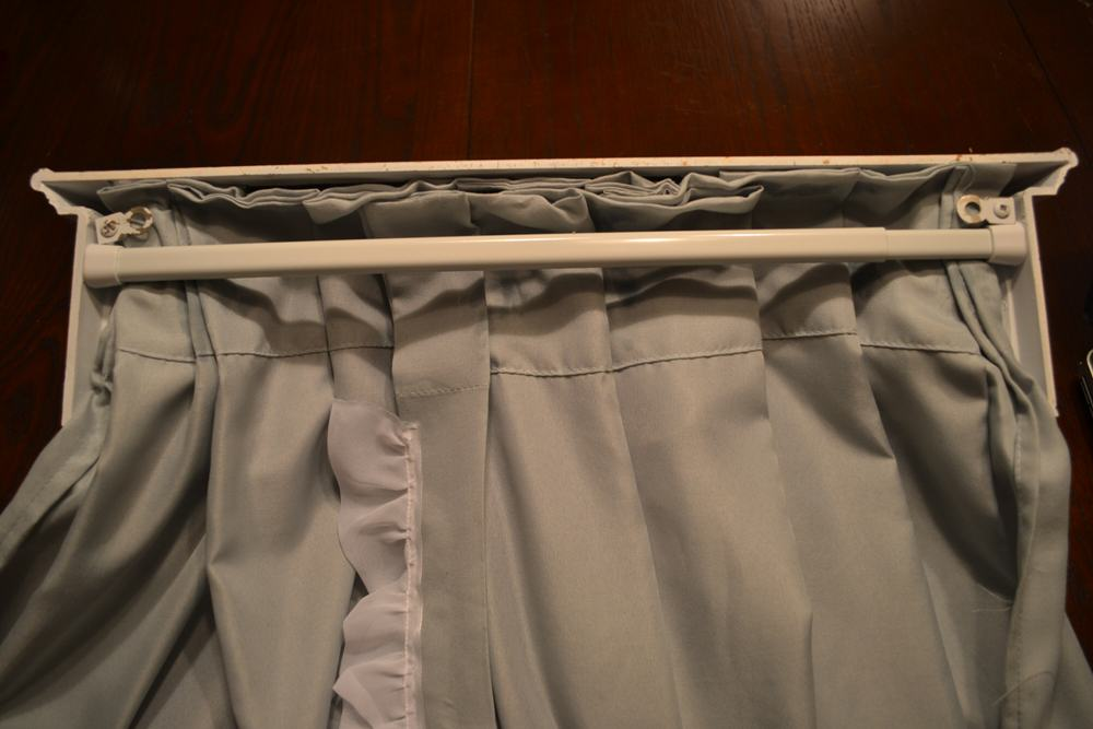 fit your rod into the back of the bed crown