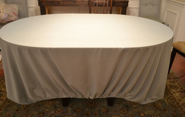 place fitted sheet around table