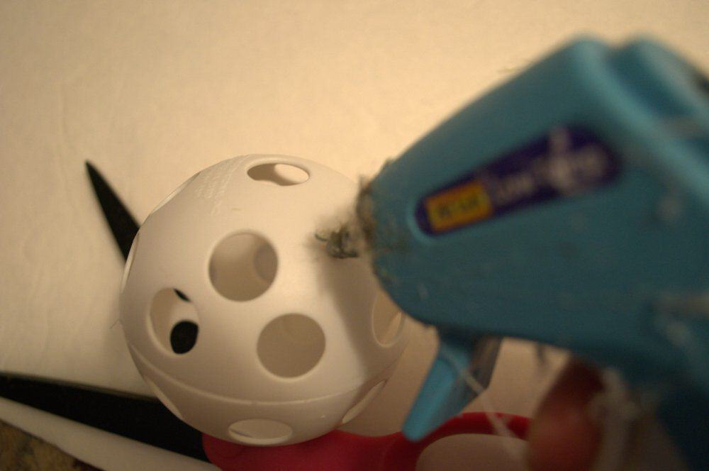 place dot of glue on ball