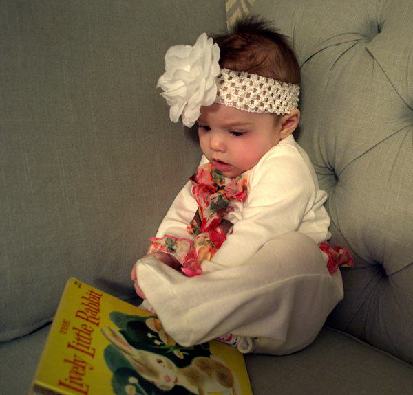 Baby Riley holding book
