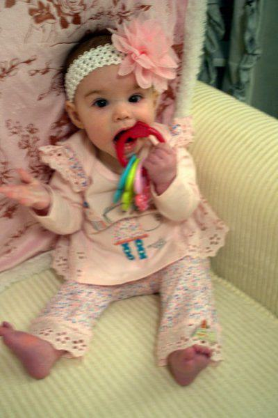 Riley playing with teething ring