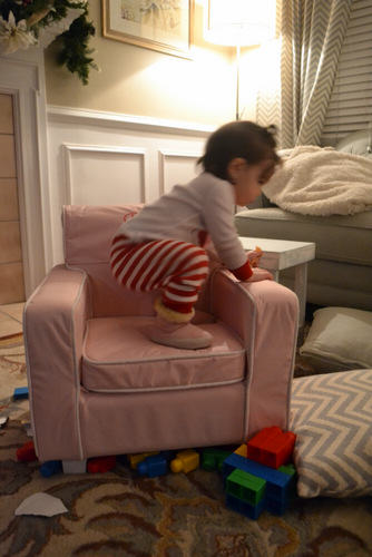 Riley climbing into her new chair