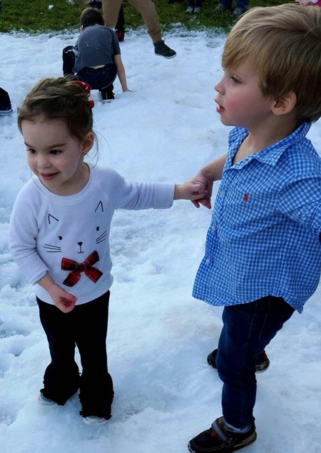 riley and luke playing at christmas festival