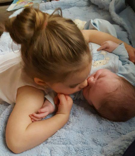 Riley loving on her little brother