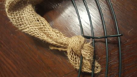 Tie Burlap in a knot around the wire frame
