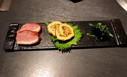1st course: assorted appetizers. From the left: smoked duck, omelet rolls, and pickled vegetable