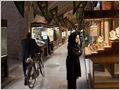 A woman observing gold jewellery in one of the shops insede Kerman Bazaar, Iran.