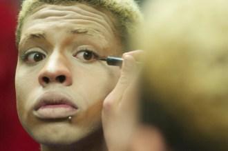 Avon M. Larouxx applies makeup before the Drag Show Feb. 14 at the Tivoli Turnhalle. Photo by Ryan Borthick ¥ rborthic@msudenver.edu