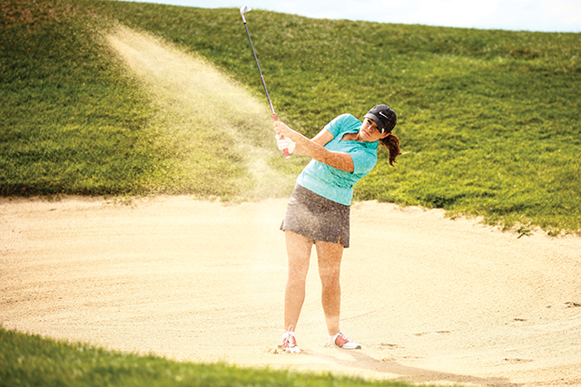 Then-freshman recruit Sabrina Naccarato hits the ball out of the bunker during the women's golf tryouts Aug. 27, 2013. Metro captured their first ever tournament win in the programs two year history Sept. 16, 2014 at the RMAC Event No. 1 against Colorado Christian. Photo by Philip Poston • pposton1@msudenver.edu