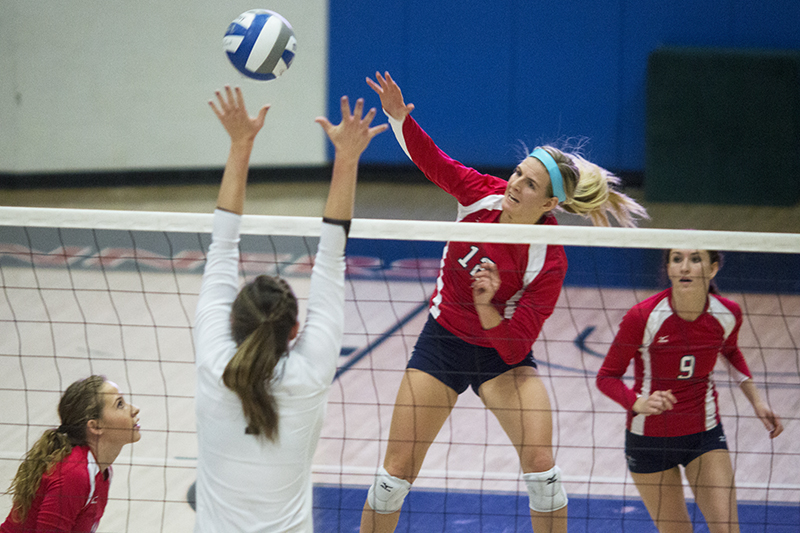 Metro senior outside hitter Summer Greager, 12, attacks the ball in the 3-1 win over UCCS Nov. 17 at the Auraria Event Center. Photo by Alyson McClaran • amcclara@msudenver.edu