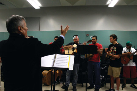 """Professor Lorenzo Trujillo conducts the armonia section as they rehearse a difficult part in the song """"El Son de la Negra."""" -Photo by Teresa Diaz Soriano"""