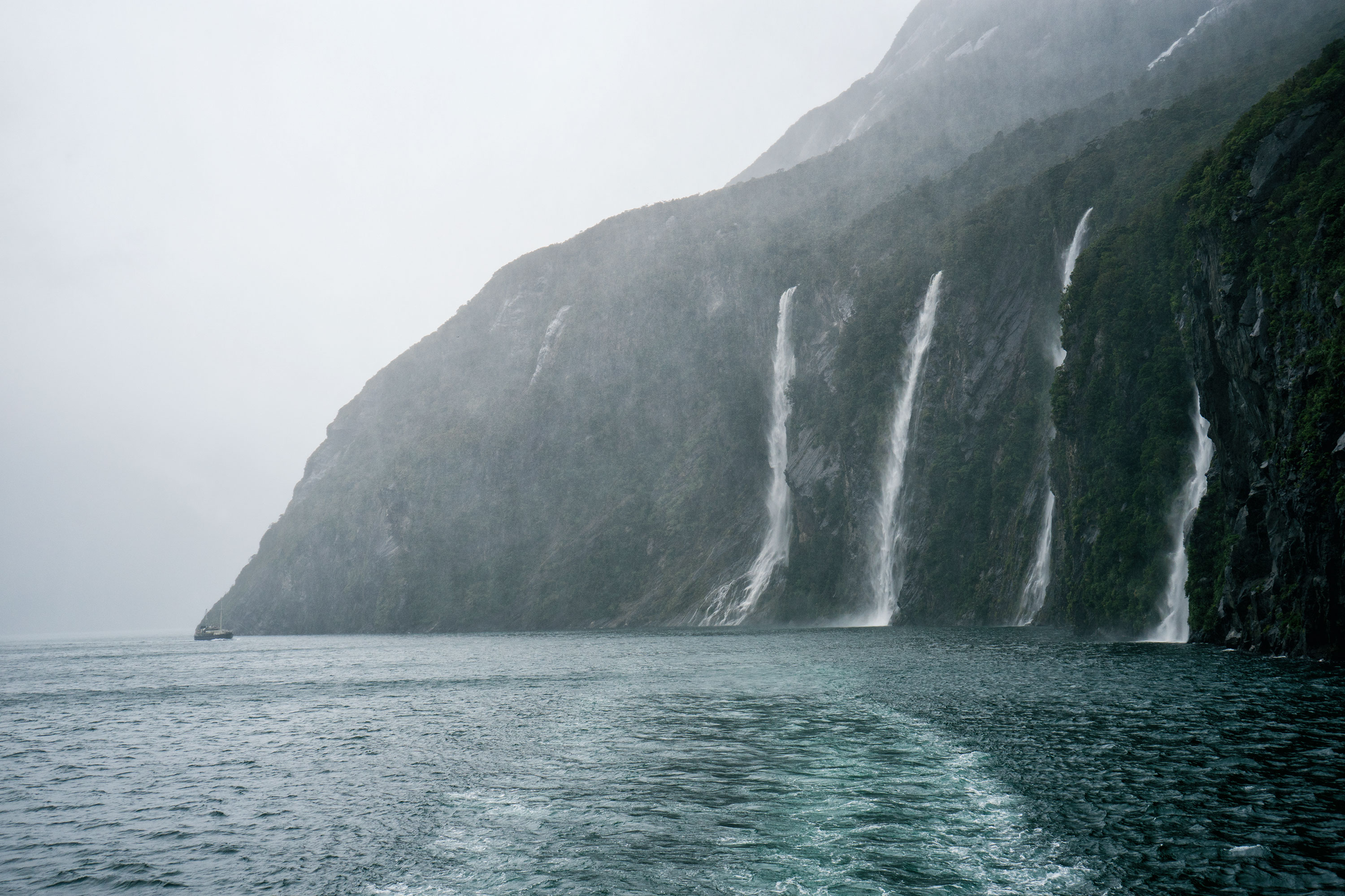 Milford Sound Waterfalls On Rainy Day