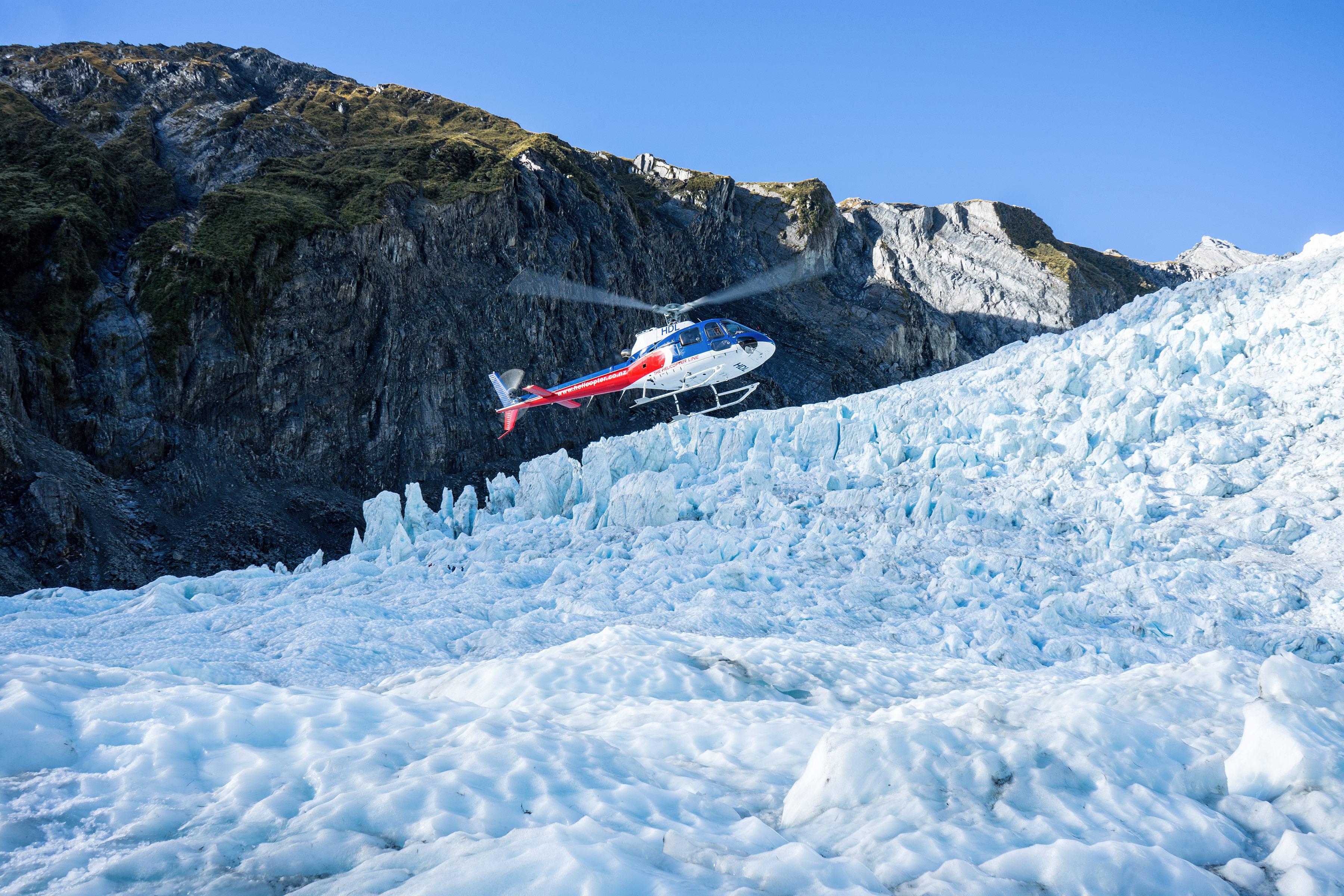 Franz Josef Glacier Heli Hike Helicopter Hovering Over Glacier