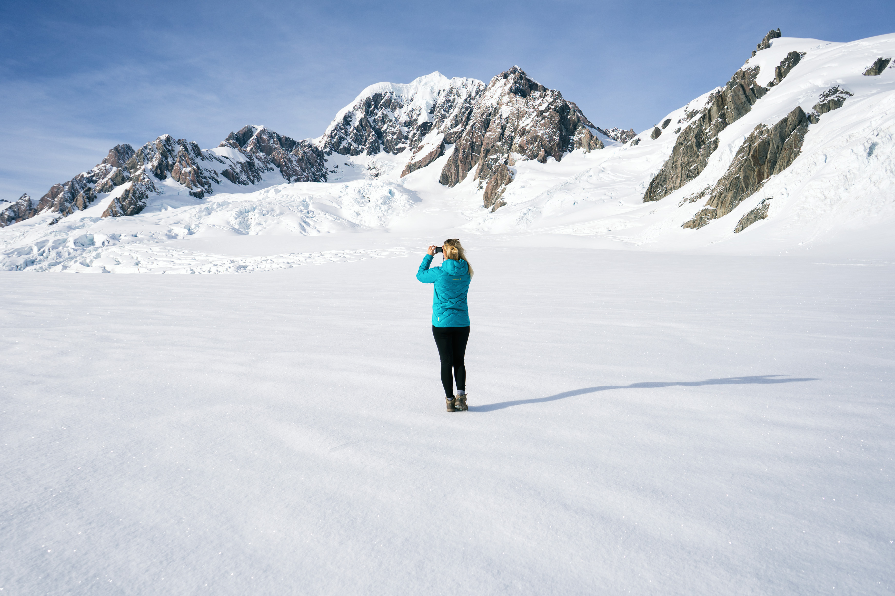 Southern Alps From Above Glacier Landing Woman Taking Photo