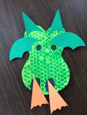 Bubble Wrap Art of a green dragon breathing fire.