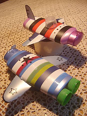recycled art project of shampoo bottles into airplanes