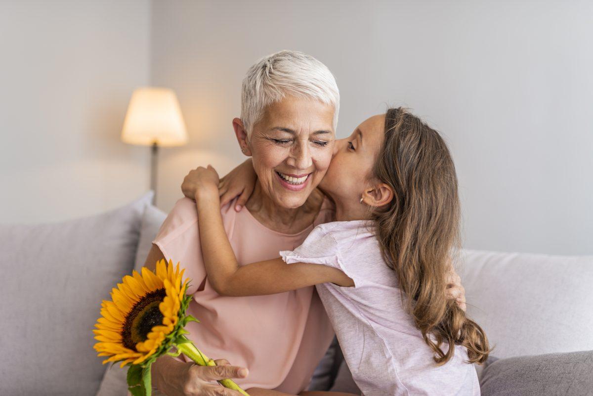 Girl giving grandma a hug