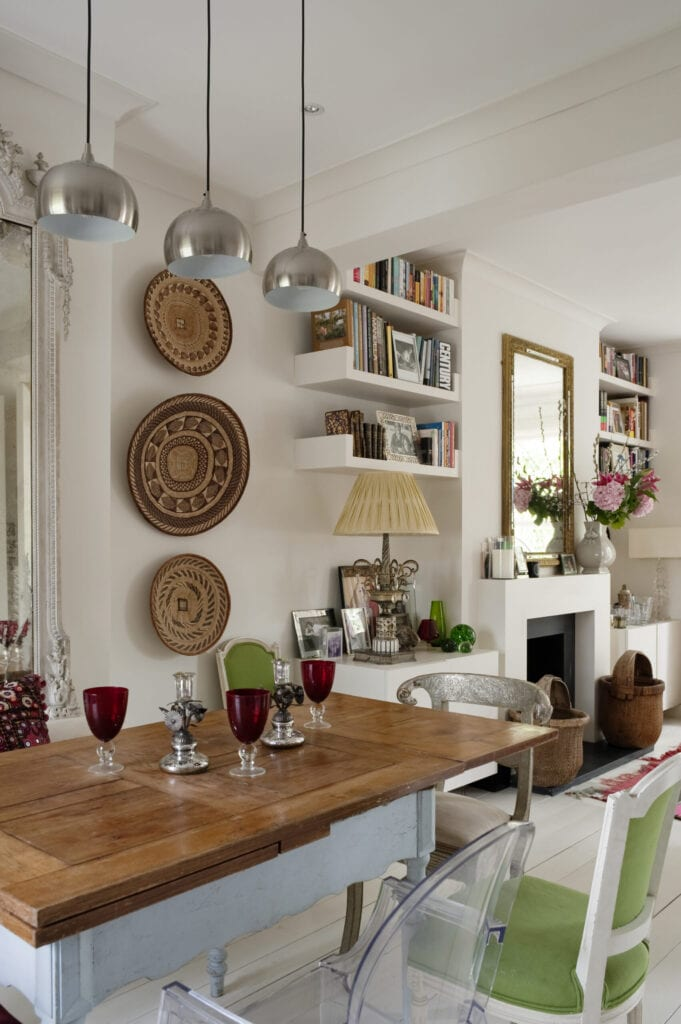 Dinging room with modern silver pendant lights, large french mirror and african coil baskets