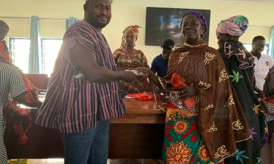 Alhaji Habib Iddrisu (left)handing the money to one of the beneficiary women