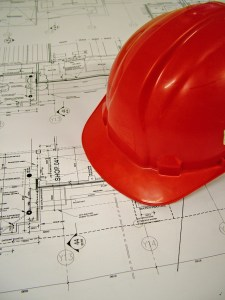 hard hat on commercial real estate blueprint