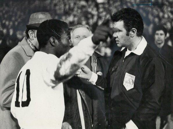 Pele reminds the ref at Villa Park, jthat he's just given a freekick against the God of Football