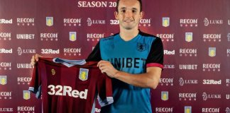 John McGinn signs for Aston Villa and holds up shirt