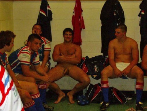 beefy_rugby_player_completely_naked_in_changing_rooms_with_team_mates