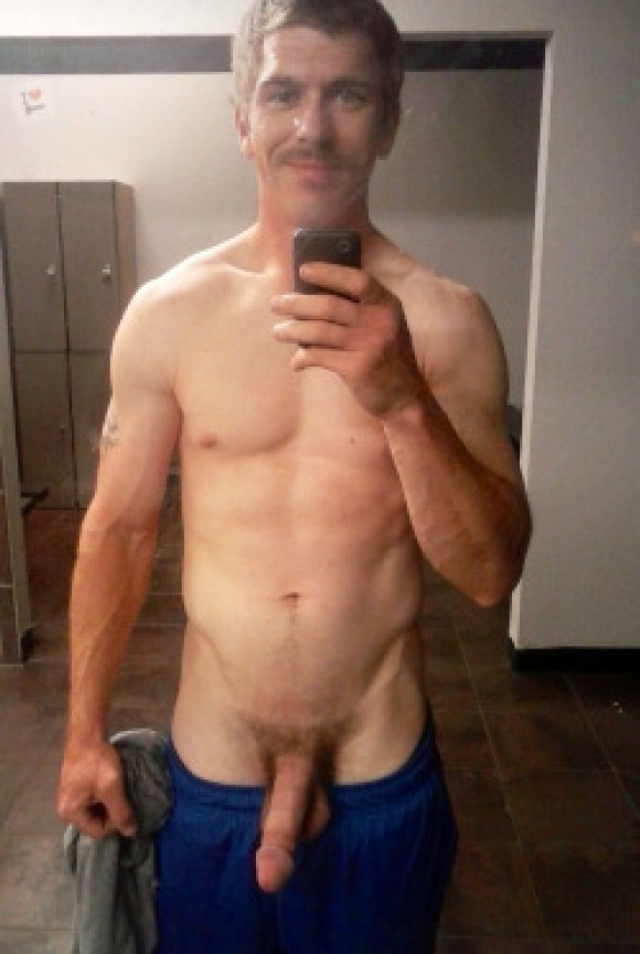mature-guy-showing-off-at-dressing-room