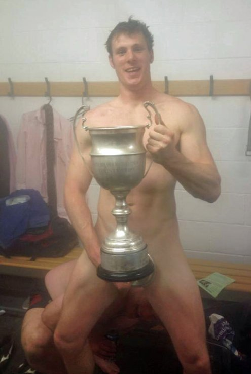 pic1_fit_lithe_footballer_naked_with_cup_in_locker_room_001