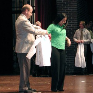 a modern white coat ceremony