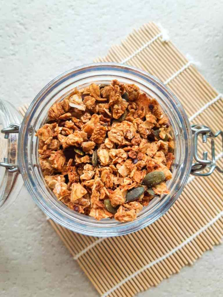 A close up overhead shot of the homemade oeanut butter granola in a jar.