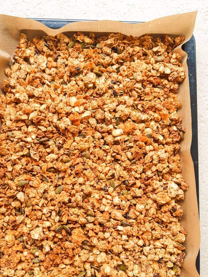 Homemade peanut butter granola in a baking tray.