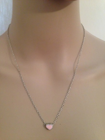 """Delicate silver tone 16"""" link chain holds a tiny pale pink or pale blue enamel heart."""