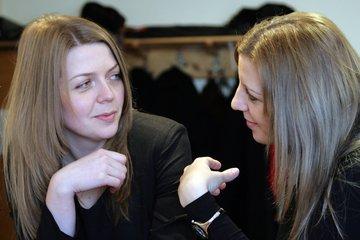 Two happy looking women talking