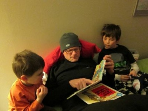 father reading to his children