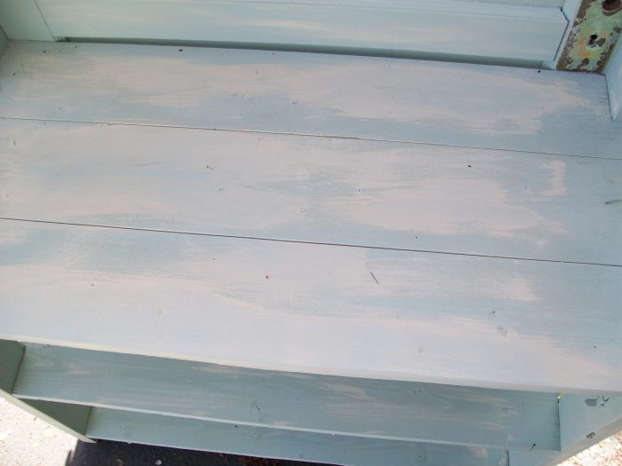 dry brush painting bookshelf made from a door