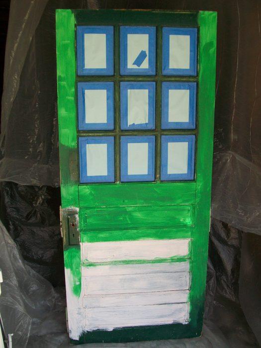 repurposed door bookshelf in paint booth ready for paint sprayer