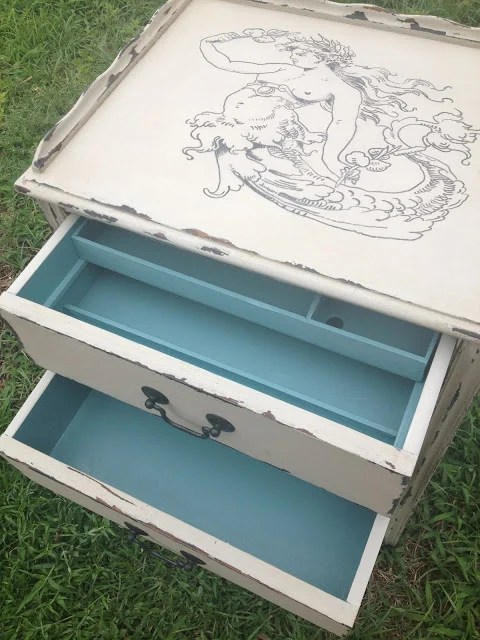 sewing table with blue drawers