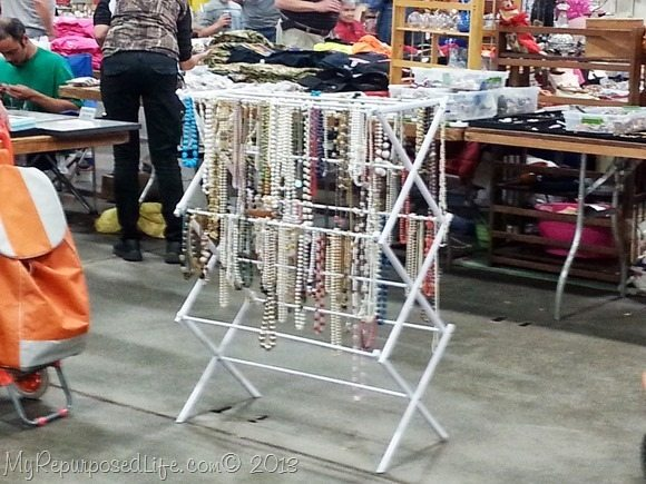 clothes rack repurposed to display jewelry